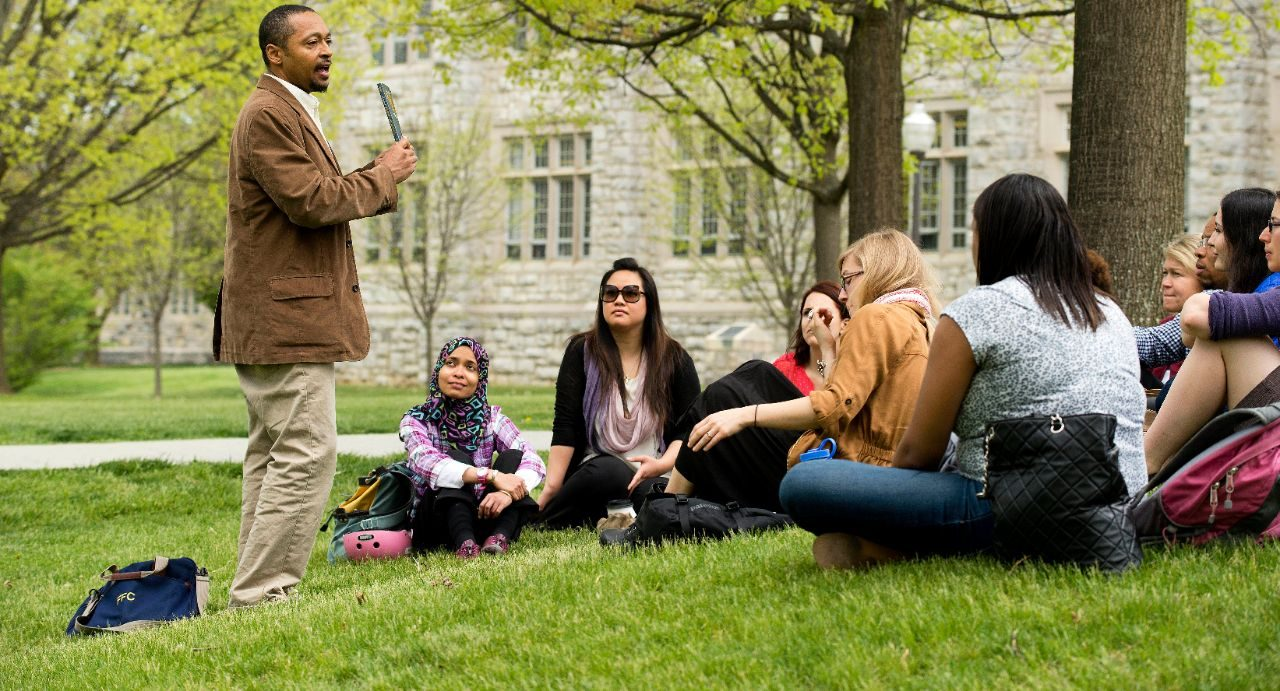 Virginia Tech Professor Kwame Harrison teaching in classroom and outdoors on campus with graduate students in sociology.